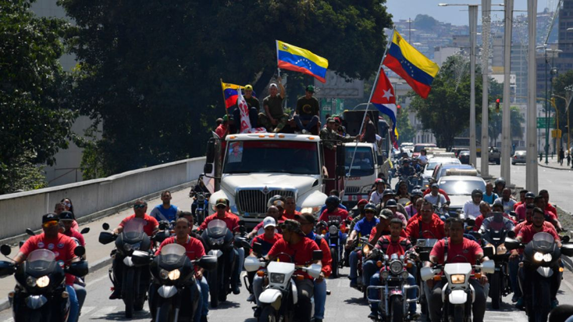Supporters of Venezuelan President Nicolás Maduro on motorcycles, trucks and cars take part in a rally around the city in Caracas, Venezuela on January 7, 2019.