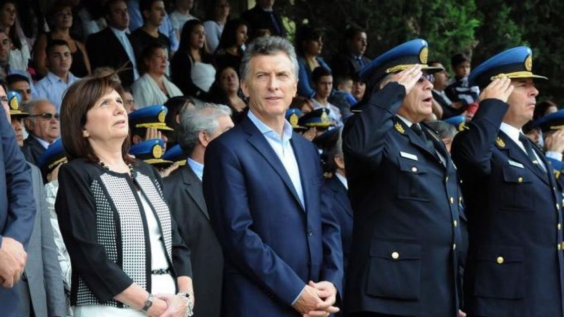 Security Minister Patricia Bullrich with President Mauricio Macri at an event alongside Police chiefs.