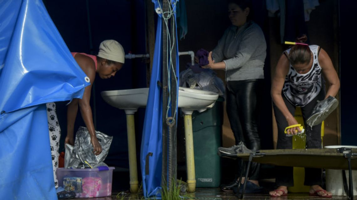 Venezuelan migrants wash their clothes in a humanitarian camp in Bogotá, Colombia.