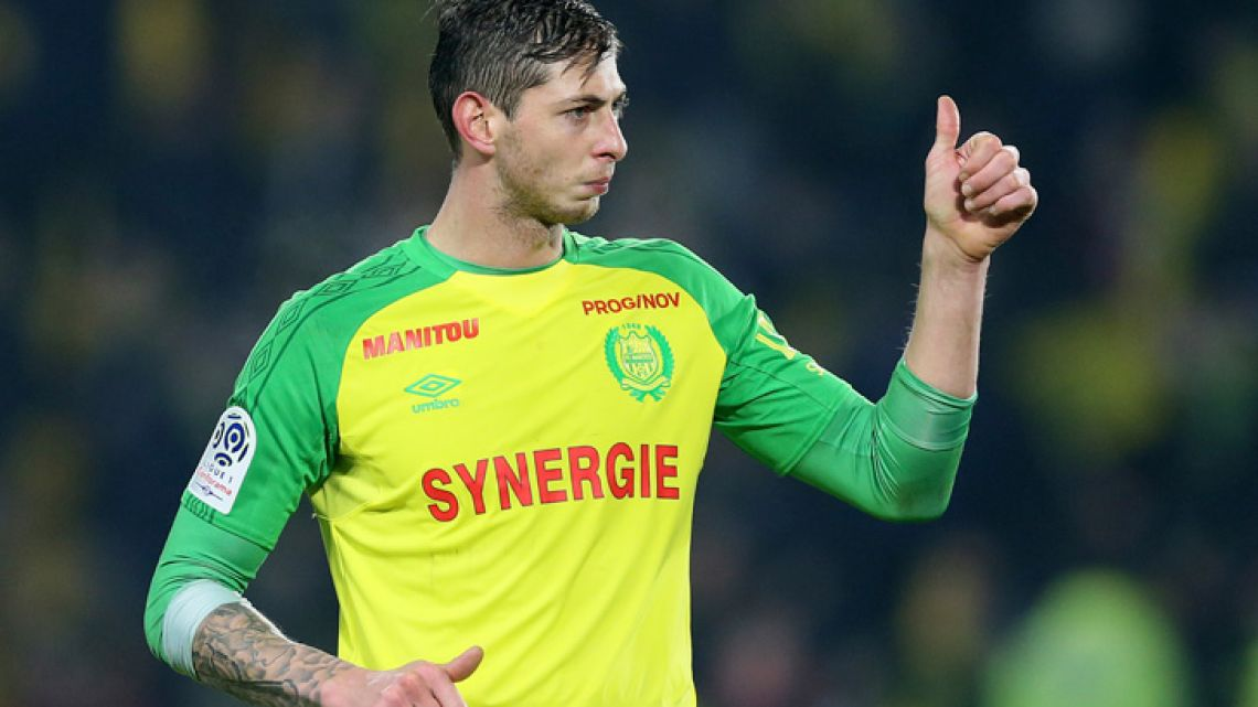 In this his picture taken on January 14, 2018, Argentine footballer Emiliano Sala, then of FC Nantes, gives a thumbs up during a match against PSG. The French civil aviation authority says Sala, who had just completed a multi-million-euro move to Premier League Club Cardiff City was aboard a small passenger plane that went missing off the coast of the island of Guernsey.