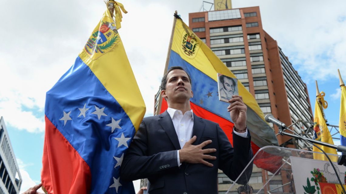 "Venezuela's National Assembly head Juan Guaidó declares himself the country's ""acting president"" during a mass opposition rally against leader Nicolás Maduro on January 23, 2019."