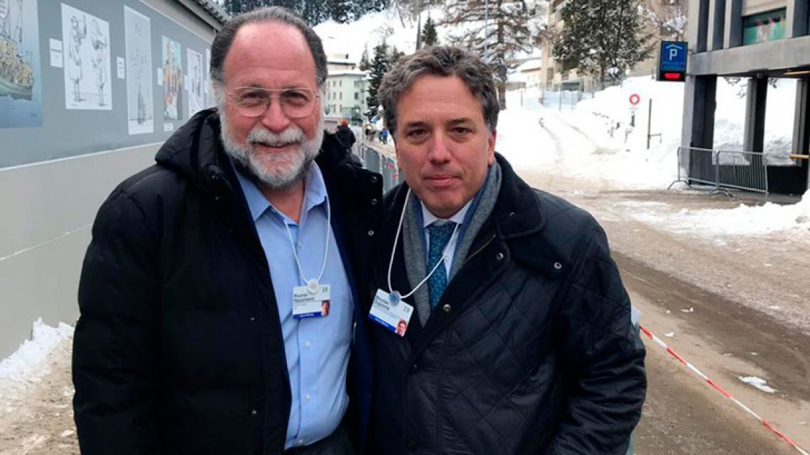 Finance Minister Nicolás Dujove (right), pictured with Venezuelan economist Ricardo Hausman at the World Economic Forum in Davos on Wednesday.
