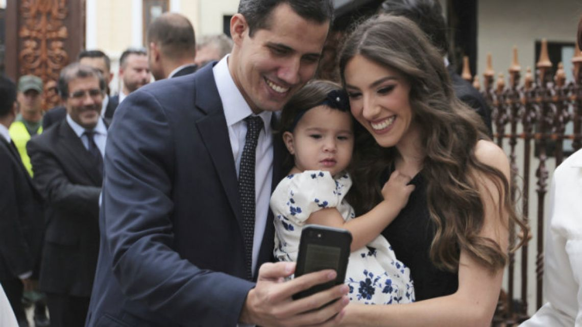 Juan Guaidó, left, takes a selfie with his wife Fabiana Rosales and his daughter Miranda, before he was sworn-in as speaker of Venezuela's National Assembly in January.