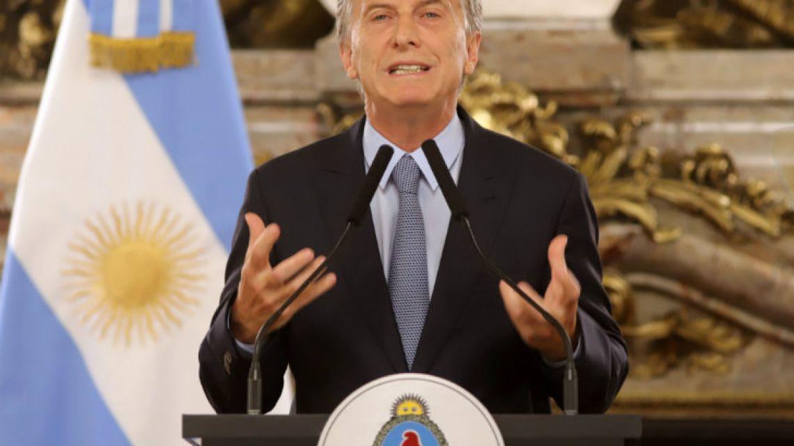 President Mauricio Macri announces his emergency 'extinción de dominio' DNU at a press conference at the Casa Rosada.
