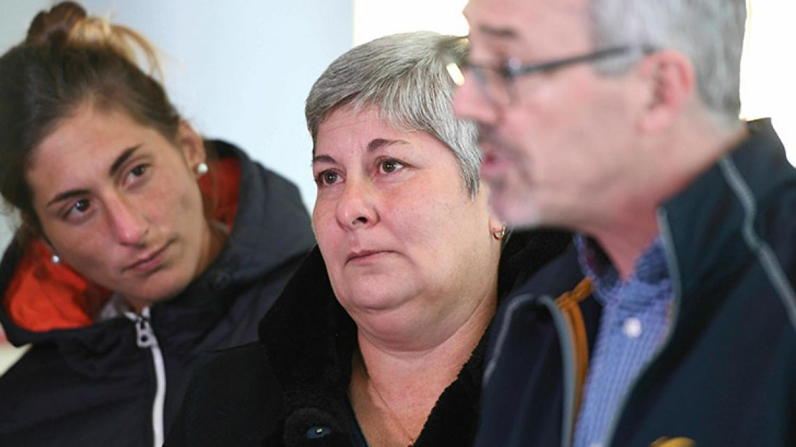 Emiliano Sala's sister Romina, left, and mother Mercedes, center, listen to Blue Water Recoveries director David Mearns talk about plans to find and recover the plane carrying the missing footballer, during a press conference at Guernsey airport, Guernsey, England, Monday, Jan. 28, 2019. More than 300,000 euros ($340,000) have been raised online to allow Sala's family to fund a private search after an official rescue operation for the light aircraft carrying Sala and pilot David Ibbotson was called off on Thursday.