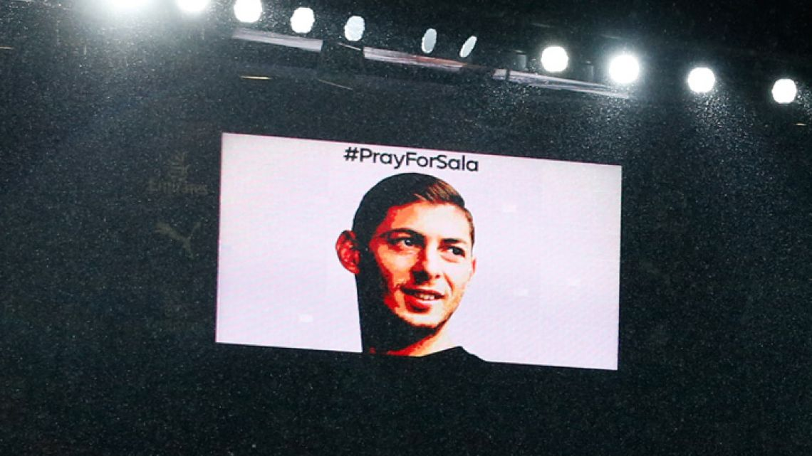 A big screen shows the face of Emiliano Sala during a moments silence in his honour ahead of the English Premier League football match between Arsenal and Cardiff City at the Emirates Stadium in London on January 29, 2019.