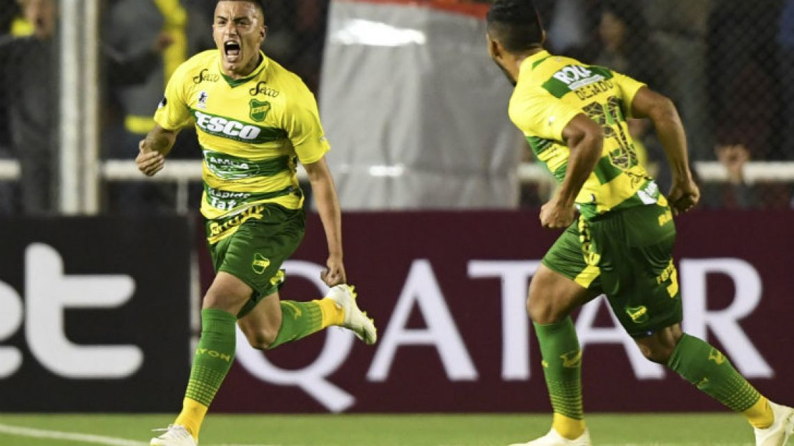 Defensa y Justicia's Leonel Miranda celebrates after scoring a goal.