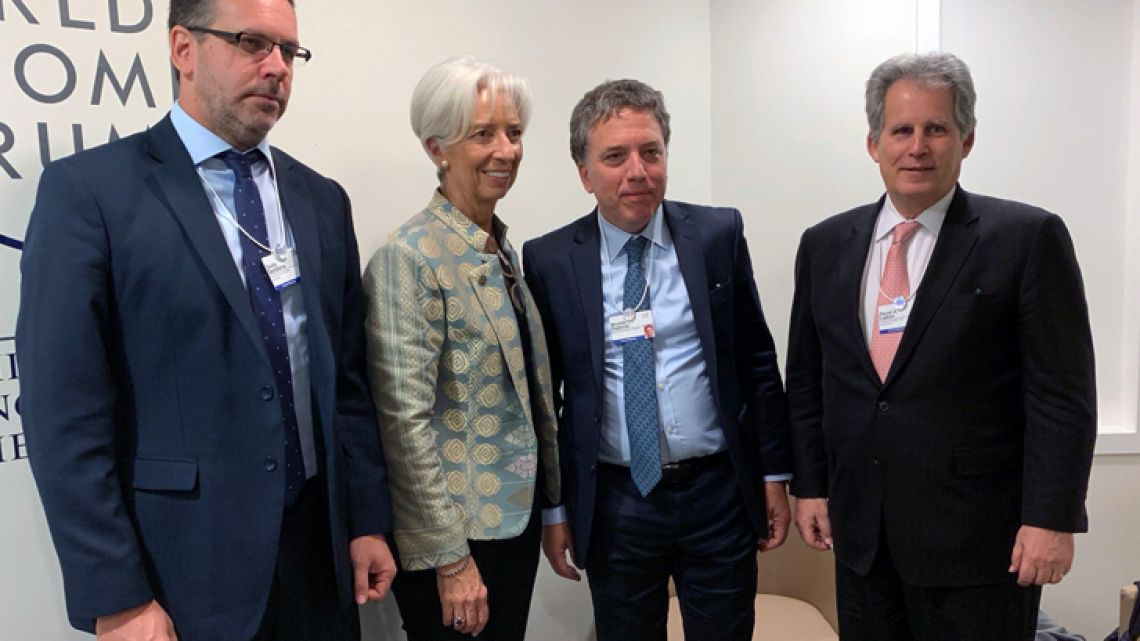IMF Chief Christine Lagarde, pictured with Argentine officials in Davos last month.