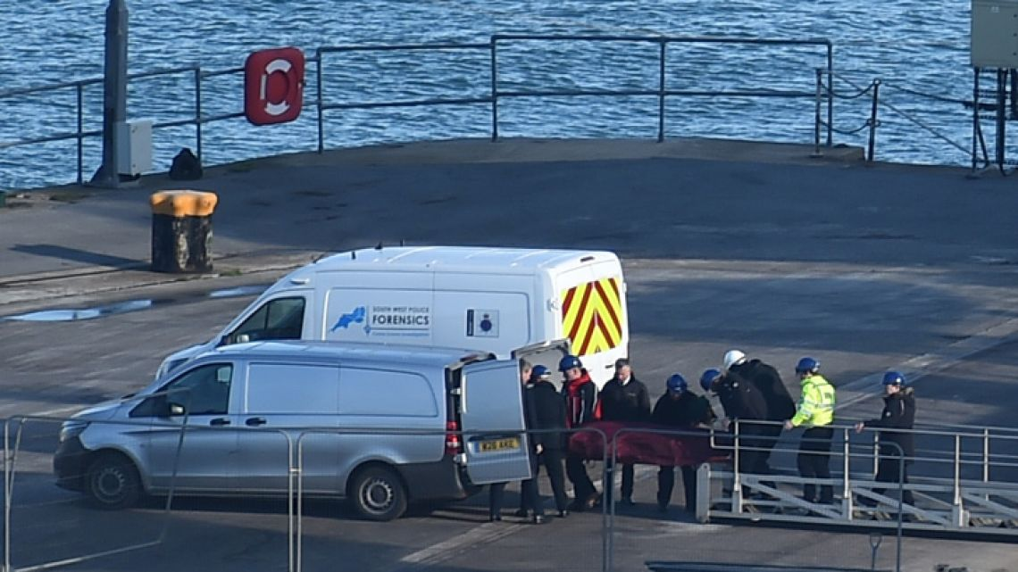 A body is taken off the Geo Ocean III, recovered from the wreckage of a plane carrying Argentine footballer Emiliano Sala at Weymouth harbour, south west England on February 7, 2019. Investigators recovered a body in the Channel and transported it to Britain today for identification. Officials later confirmed the body was that of Sala, an Argentine striker who had recently moved to Premier League club Cardiff City from French Ligue 1 side Nantes.
