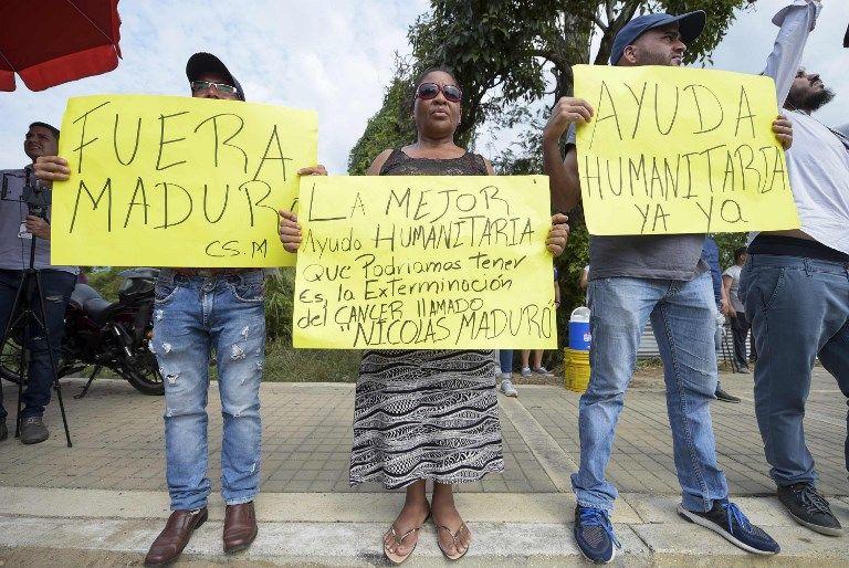 Opositores protestan en defensa de la ayuda y Maduro moviliza tropas