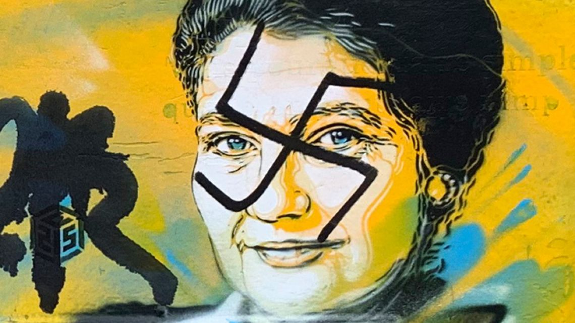 This photo taken on Monday, February 11, 2019 and provided by the Paris city hall of the XIIIth district shows a mailbox with swastikas covering the face of the late Holocaust survivor and renowned French politician, Simone Veil, in Paris, France. According to French authorities, the total of registered anti-Semitic acts rose to 541 in 2018 from 311 in 2017, a rise of 74 percent.