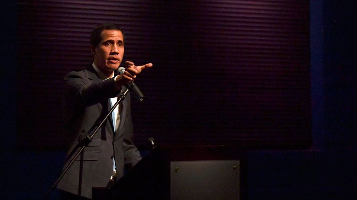 Venezuela's National Assembly head and self-proclaimed acting president Juan Guaidó gestures while speaking to students at the Metropolitan University in Caracas