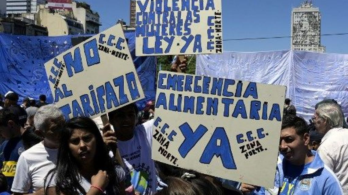 Demonstrators hold signs against high tariffs and increasing electric and gas prices during a protest against the government of President Mauricio Macri in Buenos Aires on Wednesday.