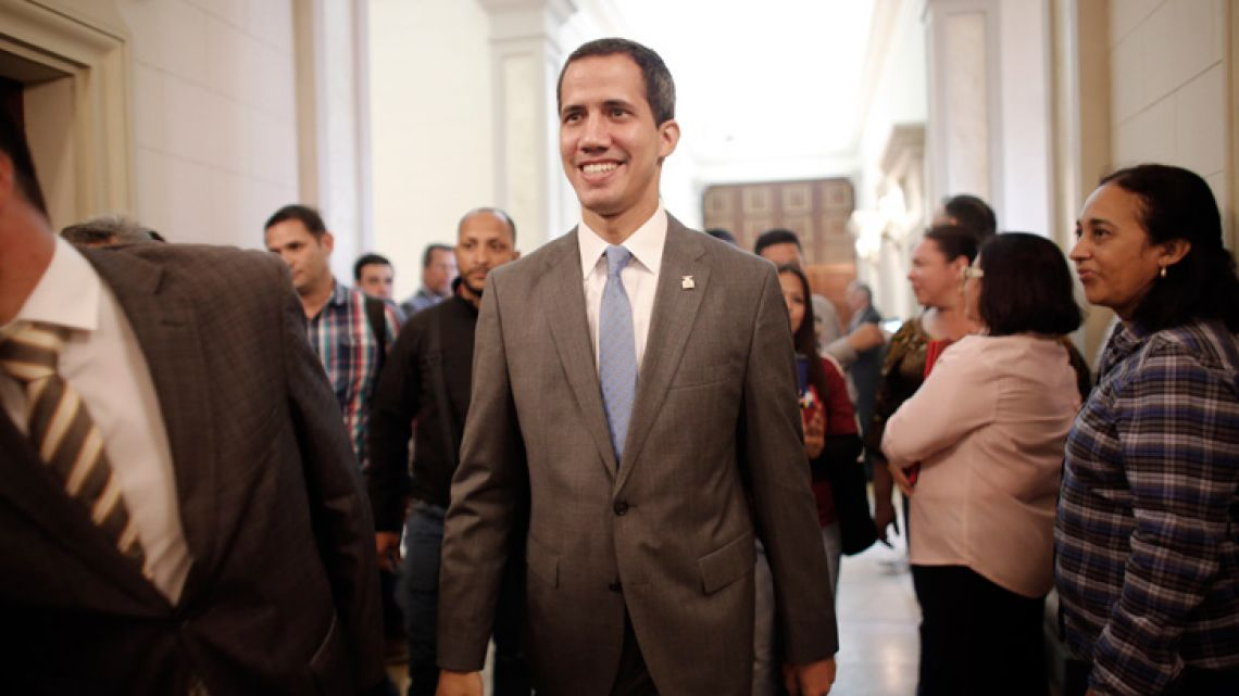 Venezuela' self proclaimed interim president Juan Guaidó smiles as he arrives at the National Assembly in Caracas.