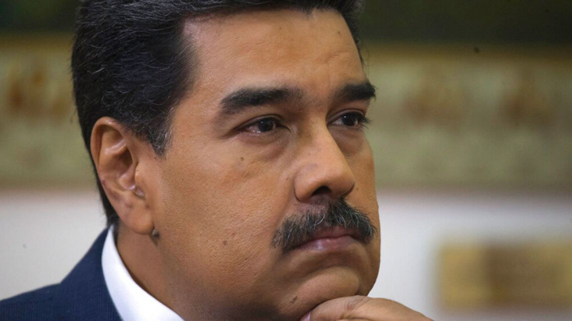 Venezuela's President Nicolás Maduro listens during an interview with The Associated Press at Miraflores presidential palace in Caracas, Venezuela, Thursday, February 14, 2019.