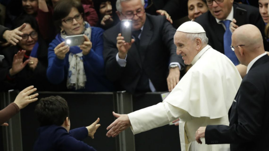 Pope Francis leaves at the end of his weekly general audience in the Paul VI Hall at the Vatican on Wednesday.