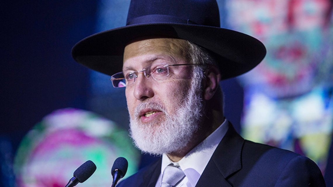 Handout photo released by AMIA showing Chief Rabbi Gabriel Davidovich delivering a speech during a dinner in Buenos Aires in November, 2018. According to the AMIA, Davidovich was assaulted and seriously injured by strangers who entered his house early on February 26, 2019 in Buenos Aires.
