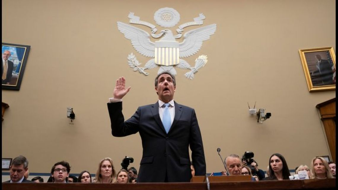 The former personal lawyer of US President Donald Trump, Michael Cohen, stands before the House Oversight and Reform Committee as he is sworn in to testify.