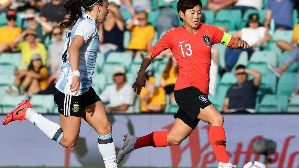 South Korea's Jeon Ga-eul and Argentina's Agustina Barroso fight for the ball during their Women's Cup of Nations football match in Sydney on February 28, 2019.