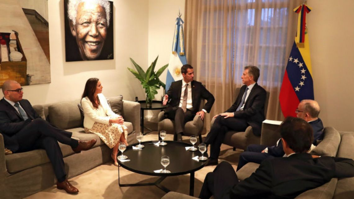 Venezuela's self-proclaimed interim president Juan Guaidó (centre-left) left, speaks with Mauricio Macri at the Olivos presidential residence.