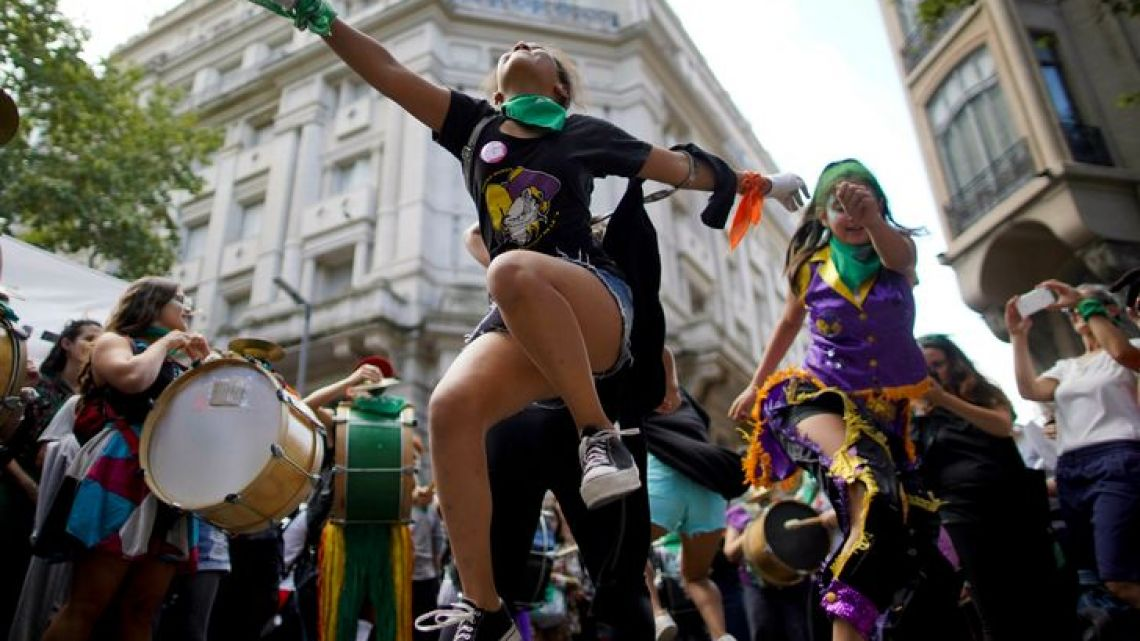 Women dance in the streets of Buenos Aires, Argentina, while celebrating International Women's Day on March 8, 2019.