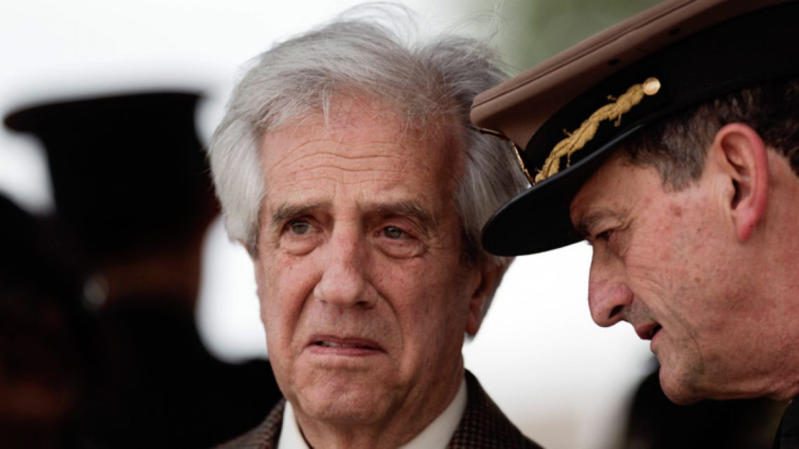 In this October 29, 2018 photo, Uruguay's President Tabaré Vázquez, left, listens to then-commander-in-chief of the Army, Guido Manini Ríos, during a ceremony in Montevideo.