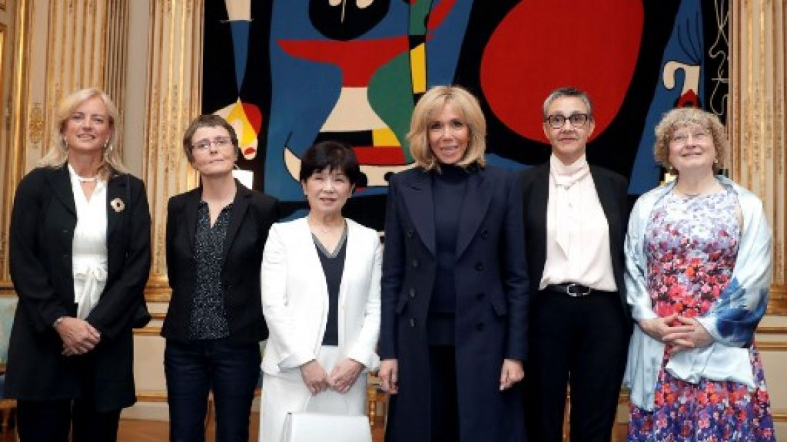"French president's wive Brigitte Macron poses with the five awarded women of the ""Unesco International Prize for Women and Science"", including Karen Hallberg of Argentina on the left."