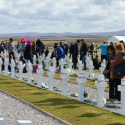 The Malvinas winds eased and the sun came out as family members mourned.