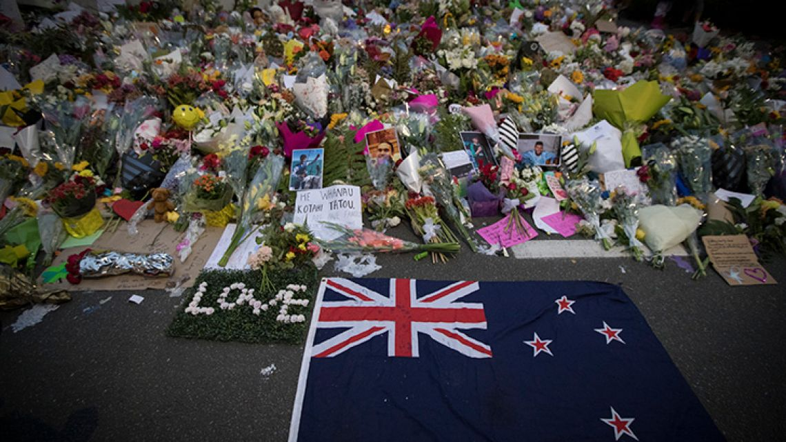 Mourners lay flowers on a wall outside the Al Noor mosque in Christchurch, New Zealand.