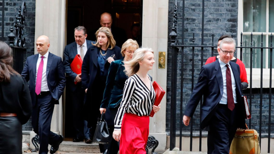 Cabinet ministers leave 10 Downing Street in London after a meeting on Brexit. Britain has asked EU leaders to delay Brexit until June 30, Prime Minister Theresa May told Parliament on Wednesday, on the eve of an EU summit in Brussels.