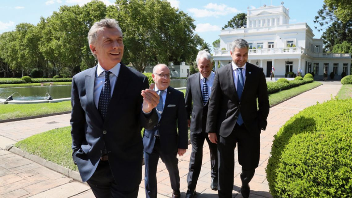 Handout picture released by the Presidency shows President Mauricio Macri, Foreign Minister Jorge Faurie, Chile's President Sebastian Piñera and Paraguay's President Mario Abdo Benítez at the Olivos presidential residence on March 20, 2019.