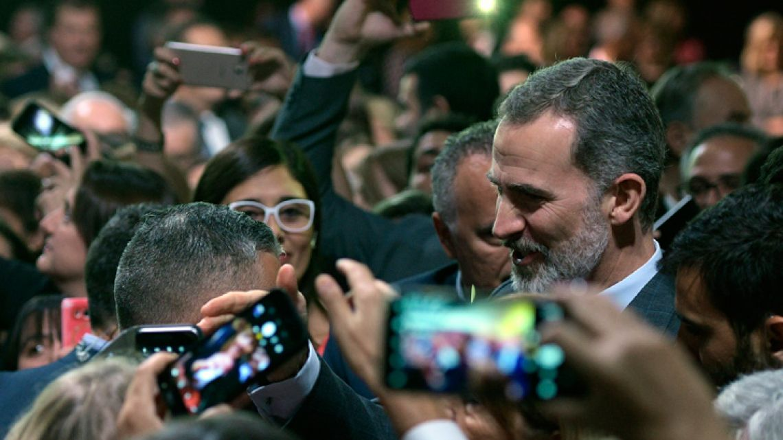Spain's King Felipe VI greets members of the Spanish community living in Argentina, during a meeting in Buenos Aires, on March 26, 2019.