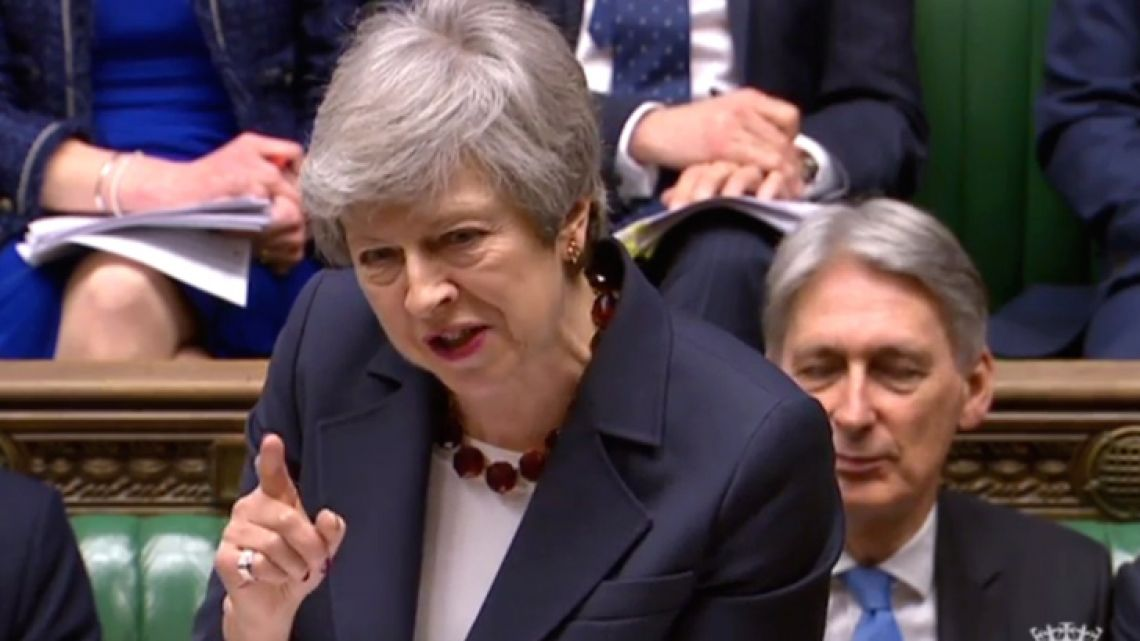 A video grab from footage broadcast by the UK Parliament's Parliamentary Recording Unit (PRU) shows Britain's Prime Minister Theresa May speaking during the weekly Prime Minister's Questions (PMQs) question and answer session in the House of Commons in London on March 27, 2019. Britain's parliament on Wednesday holds a series of votes to seek an alternative Brexit solution as pressure mounts on Prime Minister Theresa May to resign if she wants her own unpopular plan approved.