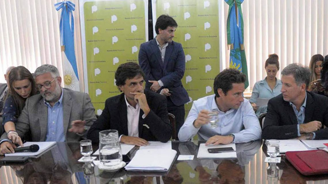 Buenos Aires province's Economy Minister Hernán Lacunza (second left) with officials from the Vidal administration during wage bargaining.