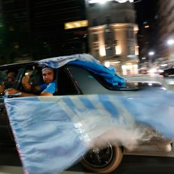 Racing Club fans drive around town celebrating after their team clinched the Argentine Superliga Championship title, in Buenos Aires, Argentina, Sunday, March 31, 2019.