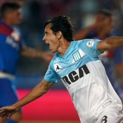 Racing Club's midfielder Augusto Solari celebrates scoring against Tigre.