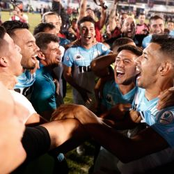 Racing Club players and staff celebrate clinching the Superliga Championship title, after a match against Tigre on the outskirts of Buenos Aires.