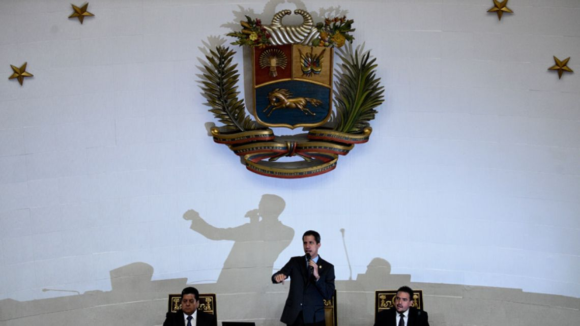 Venezuelan opposition leader and self-proclaimed interim president Juan Guaidó (centre) is flanked by National Assembly's First Vice-President Edgar Zambrano (left) and Second Vice-President Stalin González as he speaks during a National Assembly session in Caracas on April 2, 2019.