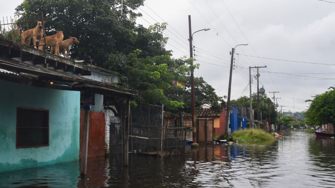 Picture taken in a flooded area of Asunción on April 3, 2019 after the overflowing of the Paraguay River due to heavy rain in the past weeks. The municipality of Asuncion declared a three-month emergency after the floods along the Paraguay river caused the evacuation of thousands of people living along its banks.