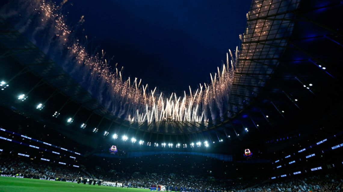 Fireworks explode above the stadium as the teams stand on the pitch before the start of the English Premier League match between Tottenham Hotspur and Crystal Palace, the first Premiership match at the new Tottenham Hotspur stadium in London, Wednesday, April 3, 2019.