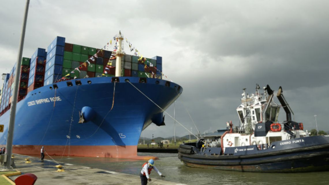 A Panama Canal worker docks the Chinese container ship Cosco at the Panama Canals' Cocoli Locks, in Panama City. China's expansion in Latin America of its Belt and Road initiative to build ports and other trade-related facilities is stirring anxiety in Washington.