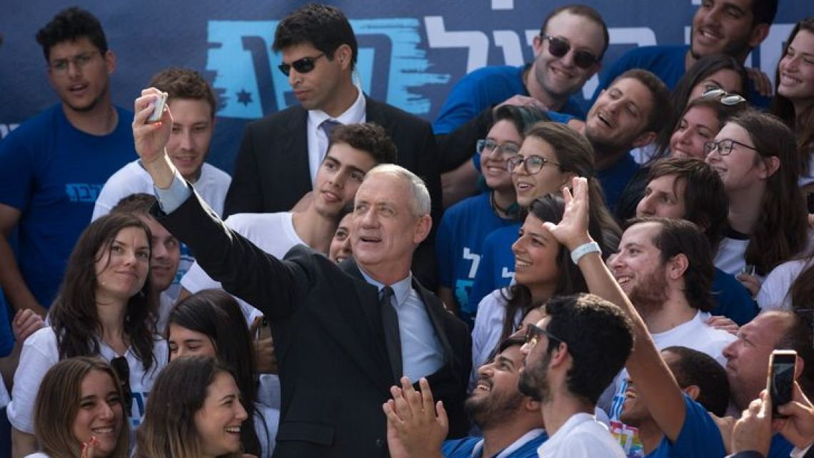 Benny Gantz, the Blue and White party leader and the man to challenge Benjamin Netanyahu in the upcoming Israeli election,  takes pictures with his supporters during a campaign rally in Tel Aviv, Israel, on Monday, April 8, 2019.