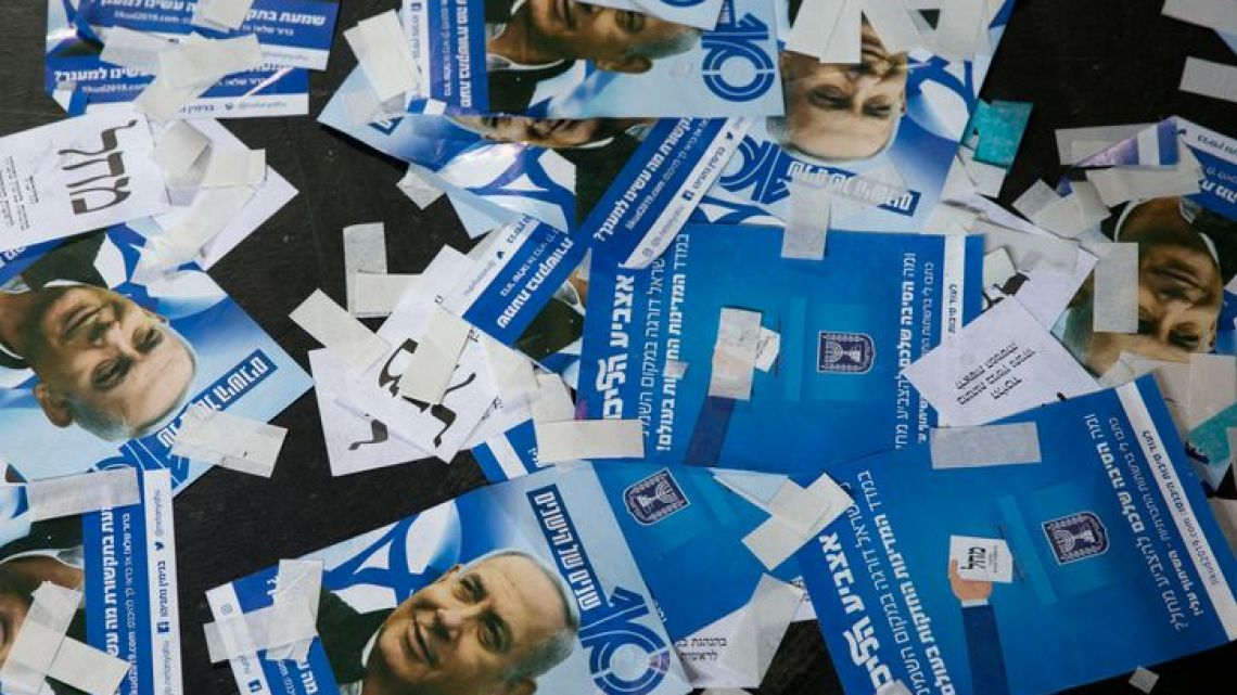 Likud party ballot papers and Israel's Prime Minister Benjamin Netanyahu's campaign fliers litter the ground as polls have officially closed for Israel's general election on Wednesday, April 10, 2019, in Tel Aviv, Israel.