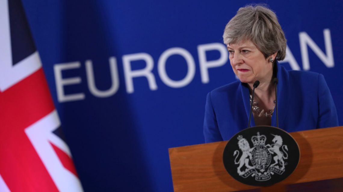 British Prime Minister Theresa May speaks during a press conference at the conclusion of an EU summit in Brussels.