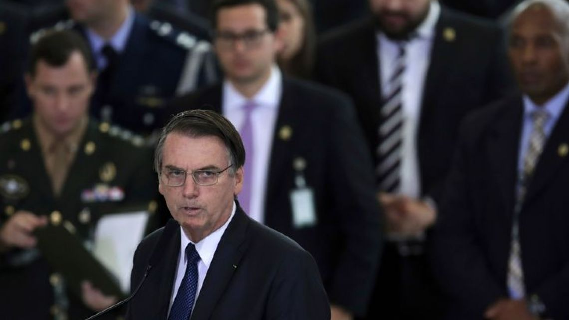 Brazil's President Jair Bolsonaro speak during a ceremony at the Planate Presidential Palace, in Brasilia, Brazil, Thursday, April 11, 2019, marking his first 100 days in office.