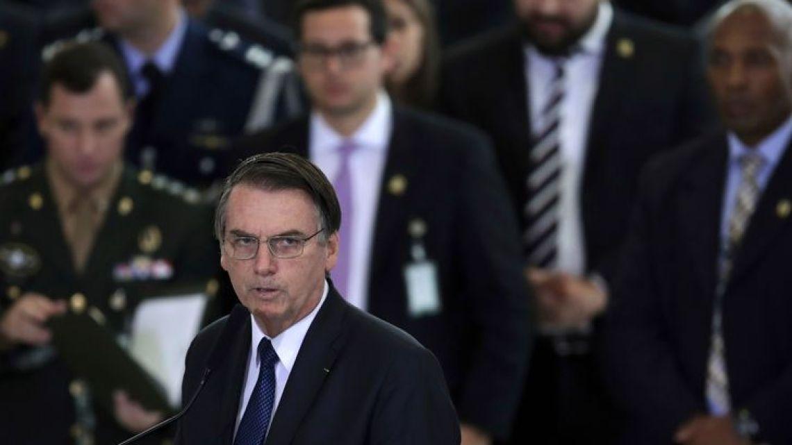Brazil's President Jair Bolsonaro speak during a ceremony at the Planate Presidential Palace, in Brasilia, Brazil, Thursday, April 11, 2019, marking his first 100 days in office.