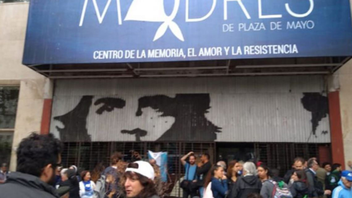 Demonstrators meet outside the headquarters of the Mothers of Plaza de Mayo.