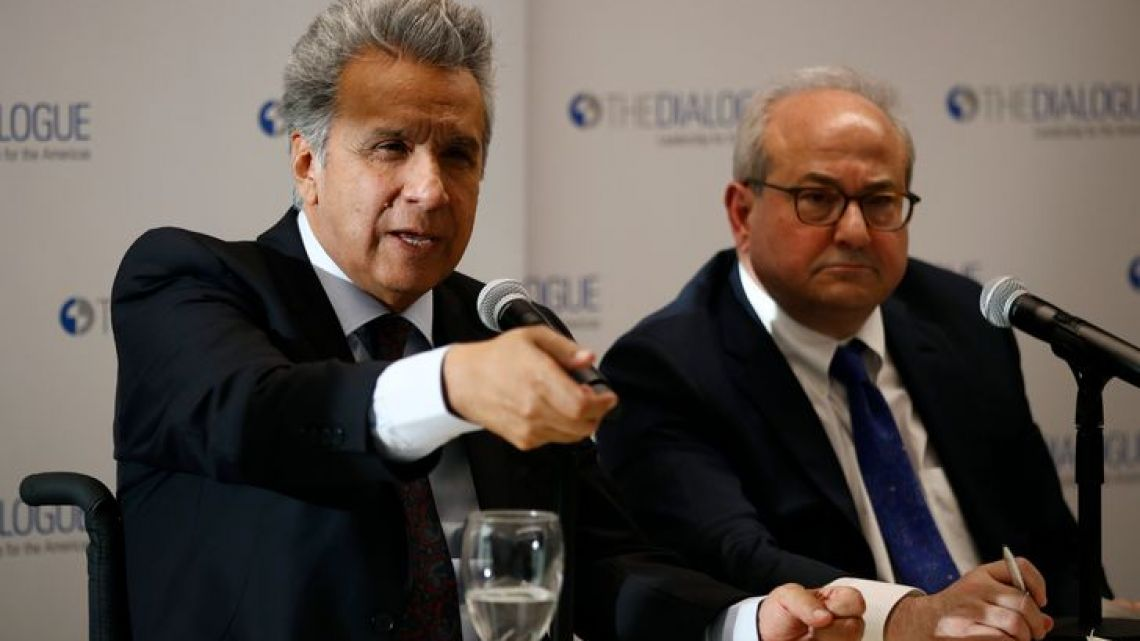 Ecuador's President Lenin Moreno, left, speaks at an event at the Inter-American Dialogue think tank, Tuesday, April 16, 2019, in Washington.