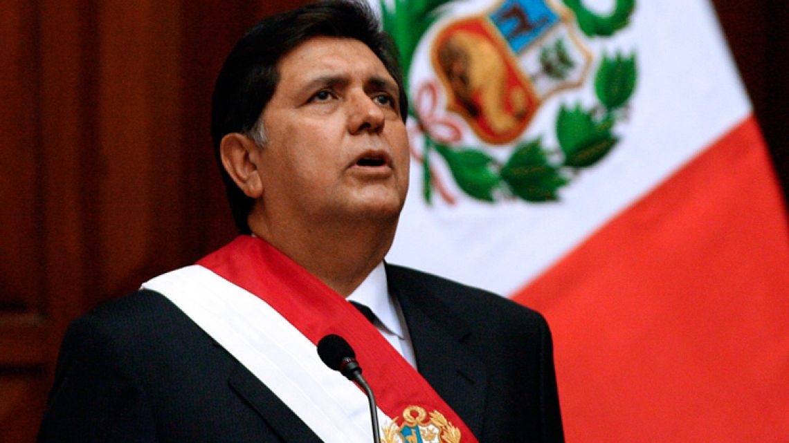 In this file picture taken on July 28, 2006, Peru's newly president, social democrat Alan García, sings the national anthem during his inauguration at the Congress in Lima. García died on April 17, 2019 after shooting himself in the head at his home, as police were about to arrest him in a sprawling corruption case, according to a member of his party.