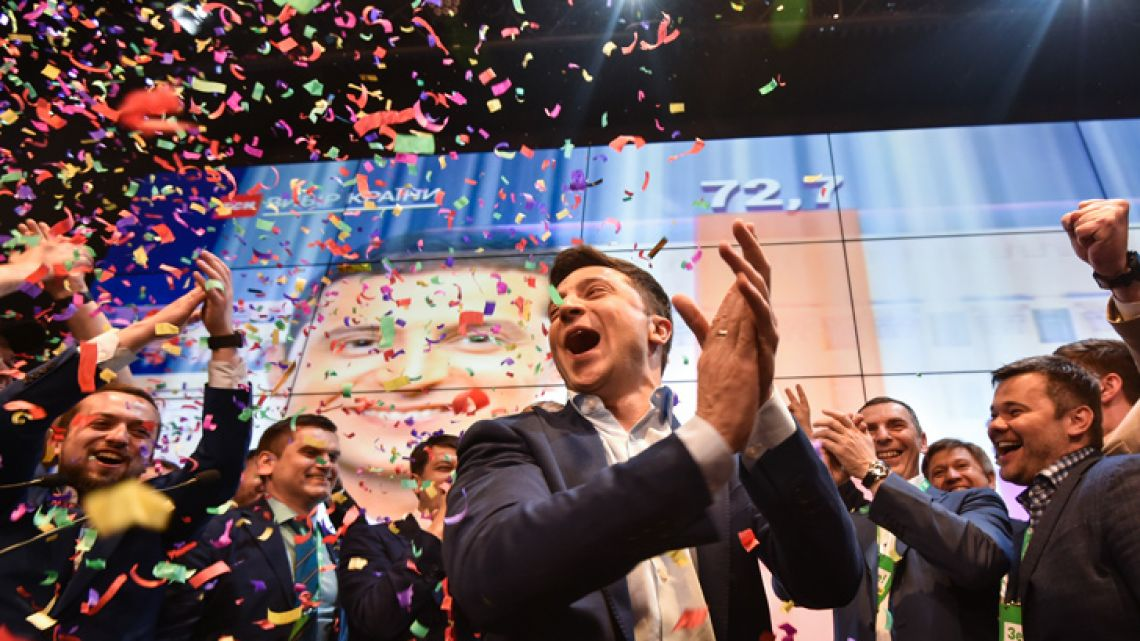 Ukrainian comedian and presidential candidate Volodymyr Zelensky reacts after the announcement of the first exit poll results in the second round of Ukraine's presidential election at his campaign headquarters in Kiev on April 21, 2019.